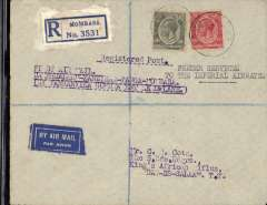 "(Kenya) Tanganyika Govt regular feeder service, first return flight, Mombasa to Dar es Salaam, bs 23/10, registered (label) airmail cover addressed to C.R.Cota, King's African Rifles, franked 65c, canc Mombasa cds, typed ""Feeder Service/To The Imperial Airways"" and ""Fist Air Mail/Dar es Salaam-Zanzibar-Tanga-Mombasa/By Government Aeroplane"", blue/white airmail etiquette."