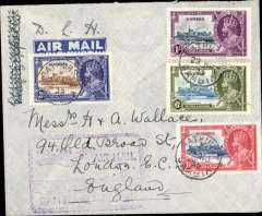 """(Gambia) Gambia to Great Britain, carried on the German air service, Bathurst to London, no arrival ds, imprint airmail etiquette cover, franked Silver Jubilee set of 4,  canc Bathurst cds, purple framed """"Airmail/Gambia-England"""" cachet, ms 'D.L.H.'. Very fine."""