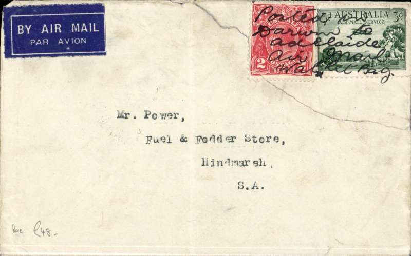 """(Australia) RARE Australian Transcontinental Airways, Darwin to Adelaide, bs 11/10, airmail etiquette cover franked 3d air + 2d ordinary, not postmarked but the stamps bear ms """"Posted in/Darwin to Adelaide/Air Mail/Wallet Bag"""". The envelope has a closed corner tear which has damage the bottom LH corner of the 2d stamp. . We believe this cover was given to one of the two pilots in Darwin prior to the final flight (this is reinforced by the fold in the middle of the cover with putting it into the pilots flying jacket pocket). A short lived air service - only eight return flights were carried out - so scarce for this reason. However the true rarity is the ms cancellation. One for the exhibit."""