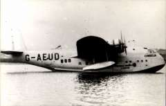"""(Ephemera) """"Cordelia"""" C Class Short Empire flying boat at mooring, Imperial Airways, later BOAC, to RAF in 1940 (as AX660), returned to BOAC in 1941 (as G-AEUD). original B&W 'Real Photographs Co Ltd' photograph."""