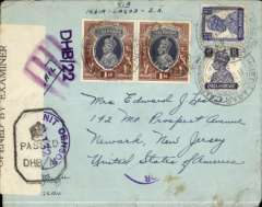 """(India) World War II dual censored commercial air cover, Ahmednagar Camp to New Jersey, no arrival ds, pale green/green envelope with crown over 'FVS' logo on flap, franked 2R 11 1/2a, ms endorsement """"Via-India-Lagos-USA"""", sealed black/white PC90 Indian censor tape tied by black hexagonal DHB (Bombay) censor mark, also purple st. line DHB/22 (Bombay)  and Military censor marks,  ms Air Mail cancelled by fine strike purple framed four bar Jusqua applied on arrival in New York, see McQueen p89. Correct rate for Pan Am South Transatlantic route for carriage by BOAC to Lagos via Persian Gulf, Cairo and Khartoum, then Pan Am FAM22 to Miami, and OAT to New York, or BOAC to Lisbon,see Boyle p791-5.  Ahmednagar Camp was a POW internment camp during WWII."""