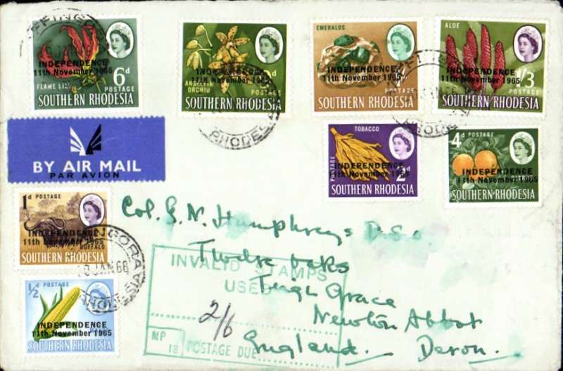 """(Rhodesia) Airmail cover franked independence 1/2d to 1/3d (8 vals), posted after the unilateral declaration of independence & stamps not accepted for postage by the British authorities, with green inland section """"invalid stamps/used/postage due (ms 2/6d)"""" cachet applied with 5x6d British postage dues affixed & tied by Newton Abbot cds. A nice piece of UDI mail."""
