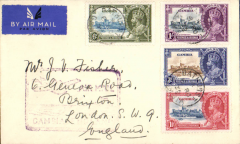 """(Gambia) Gambia to Great Britain, carried on the German air service, Bathurst to London, no arrival ds, imprint airmail etiquette cover, franked Silver Jubilee set of 4,  canc Bathurst cds, purple framed """"Airmail/Gambia-England"""" cachet, very fine."""