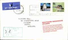 """(Rhodesia ) Airmail cover to England franked 2 1/2c & 12 1/2c 1970 new decimal currency issued in Februry 1970 and cancelled ….'Rhodesia' machine cancel (date illegible). On arrival in Britain 2x6d & 2/6d postage dues were affixed and cancelled, also a red/white label """"Southern Rhodesia Stamps/The Goverment has announced/that stamps issued in Rhodesia of the kind used on this postal packet/have no legal basis/The Packet is accordingly surcharged"""" and a green boxed '3/6/To Pay...' hs. The British goverment withdrew the embargo in Oct 1970. A scarce memento of a politically significant event, in fine condition."""