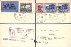 "(South Africa) Bloemfontain to Limbe, carried on board the Royal Train to connect with the F/F RANA from Salisbury, Southern Rhodesia, bs 1/3 to Nyasaland, bs 'Blantyre 9 Mar 34 3pm and 'Limbe 9 Mar 34 4.30pm', registered (hs) cover franked  9d South Africa stamps, canc black oval bilingual 'Royal Tour HRH Prince George/27.II 34/South Africa"" postmark tying black/dark blue airmail etiquette, violet two line ""First Official Air Mail"" and black two line ""S.Rhodesia/Nyasaland"" cachets. Scarce item in pristine condition. Ex Hanman Gold Medal Collection."