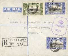 "(Sierra Leone) World War II censored registered (hs) air cover to England, no arrival ds, franked 1/6d canc Freetown oval ds, violet Sierra Leone octagonal crown over Passed/QQ censor mark, typed""Air Mail"" on flap, blue/pale blue etiquette. Likely carried in BOAC flying boat 'Catalina' along the African West Coast route from Lagos,and  round Cape Verde and the Canaries, with occasional stops at Freetown and Bathurst.. See Boyle p 721."