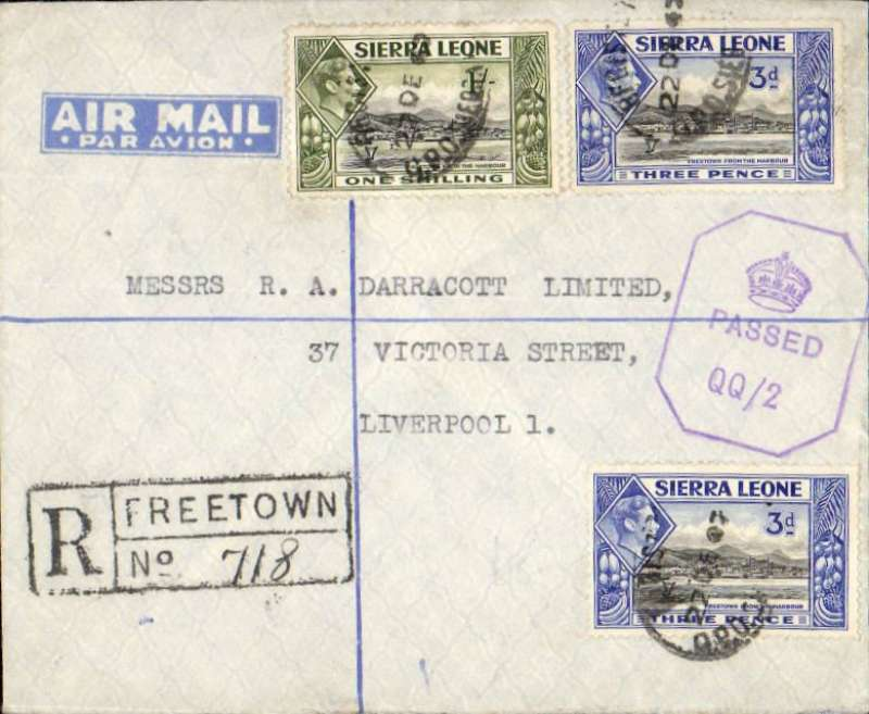 """(Sierra Leone) World War II censored registered (hs) air cover to England, no arrival ds, franked 1/6d canc Freetown oval ds, violet Sierra Leone octagonal crown over Passed/QQ censor mark, typed""""Air Mail"""" on flap, blue/pale blue etiquette. Likely carried in BOAC flying boat 'Catalina' along the African West Coast route from Lagos,and  round Cape Verde and the Canaries, with occasional stops at Freetown and Bathurst.. See Boyle p 721."""
