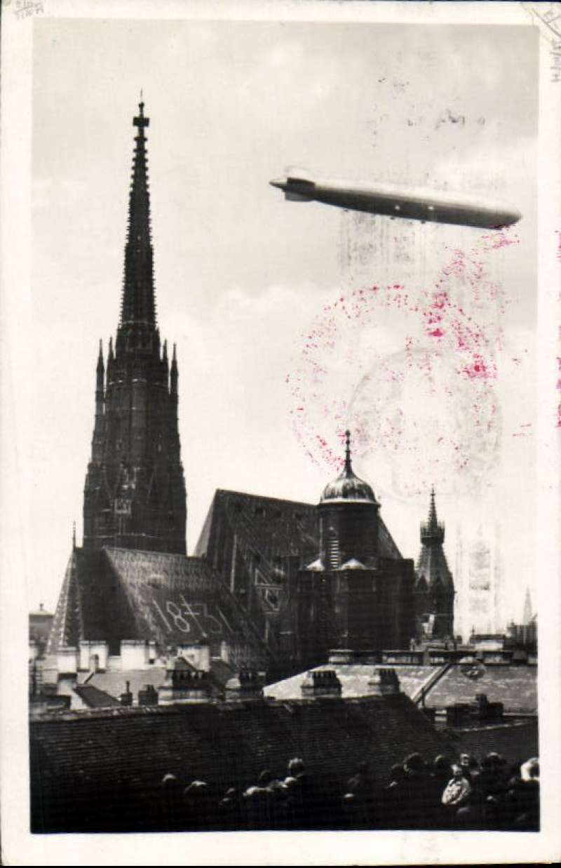 (Airship) First South America Flight, Seville first landing, 19/5 arrival machine cancel on front,  B&W PC pc showing Graf Zeppelin flying over cathedral with very tall spire, franked German 1M canc ON BOARD cds, red circular flight confirmation cachet, red three line '1, Sudamerikafahrt/..../Graf Zeppelin' hs.