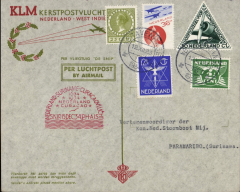 (Netherlands) Snip' Christmas flight Netherlands to Paramibo, large black 20/12 arrival cachet verso, specially printed souvenir cover franked 1o6c,  red 'domed' 15/12 depart cachet on front.. The route was Amsterdam-Marseilles-Alicante-Casablanca-Porto Praia- Paramaribo-La Guaira and finally Paramibo.