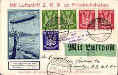 "(Airship) First flight ZR3 (LZ126) Germany to America, franked 100 pfg canc Friedrichshafen cds, New York b/s 15/10, printed souvenir PC, red ""Mit Luftschiff ZR 3 ab Friedrichshafen"" and violet oval ""Mit Luftschiff ZR 3 Befordert"" handstamps, blue/dark blue vignette depicting ZR3 flying over the Statue of Liberty, unusual green/black 'Mit Luftpost' etiquette."