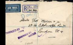 "(Recovered Interrupted Mail) Flying boat ""Cygnus"" accident at Brindisi, left Karachi en route India to England, violet two line cachet 'Damaged By/Water"" used on mail for Great Britain, Ni 371205d. Registered cover, part of the ? Indian reg label ""R/No 278..../Govt Buildings"" remains. The rest of the label and stamps have been removed neatly. An accompanying newspaper cutting dated Dec 14, 1937, and with the heading 'A Collector's Paradise' explains this. It shows a picture of a room at the GPO London where ""experts are drying out the mail and sorting the stamps to see if they have been franked"". Interesting and uncommon."