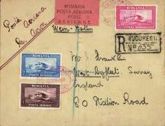 """(Romania) Early air cover to England, bs oval registered Tonbridge, Sussex 1.Jun.29 arrival ds, registered (hs) cover franked 1928 Air set f 3 and 1929 Union set of 6, cancelled red double ring Bucurest/Par Avion oval ds, ms """"Wien-Berlin"""" and  """"Par avion"""", black/salmon four line etiquette rated rare by Mair. Ironed vertical crease."""