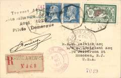 """(Ship to Shore) Ile de France, piloted by Domergue, Le Havre to New York, registered (label) cover franked 1920 10F Merson + 2x 1F50, on board hexagonal 'Le Havre to New York/19-8' cancellation, black four line """"Transet Aeriene/Catapulte Ile de France/Aout 1929/Pillote Domergue"""". Only a few were struck with this cachet. Signed by the pilot Domergue."""