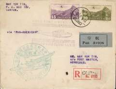 "(China) F/F FAM 14 China Clipper, Canton to Honolulu, bs 2/5, registered (label) plain cover franked $1.35 canc Canton cds,  official green ""China-USA First Flight"" circular cachet, also violet ""Hong Kong to Honolulu/Received First Flight - FAM 14"" cachet, typed 'Via Pan American', grey blue/black airmail etiquette. Dispatches from Canton are much scarcer than those from Shanghai. Slight even toning on front, and few tone spots verso. See scans."