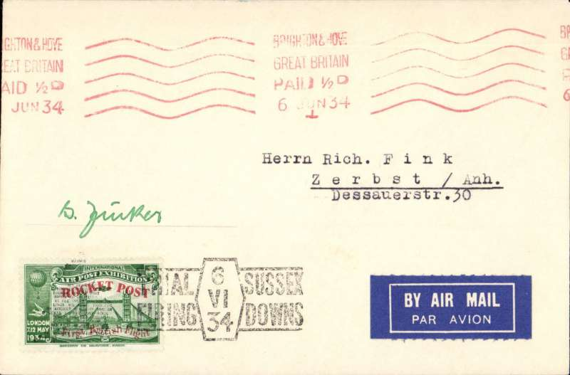 (GB Internal) Cover flown on Zucker's first trial rocket flight on the Sussex Downs, bearing green 1934 Apex vignette overprinted red for the rocket post, hand stamped with the trial firing cachet in black, red machine postmark  Brighton 6 June 1934. Signed by Gerhard Zucker.