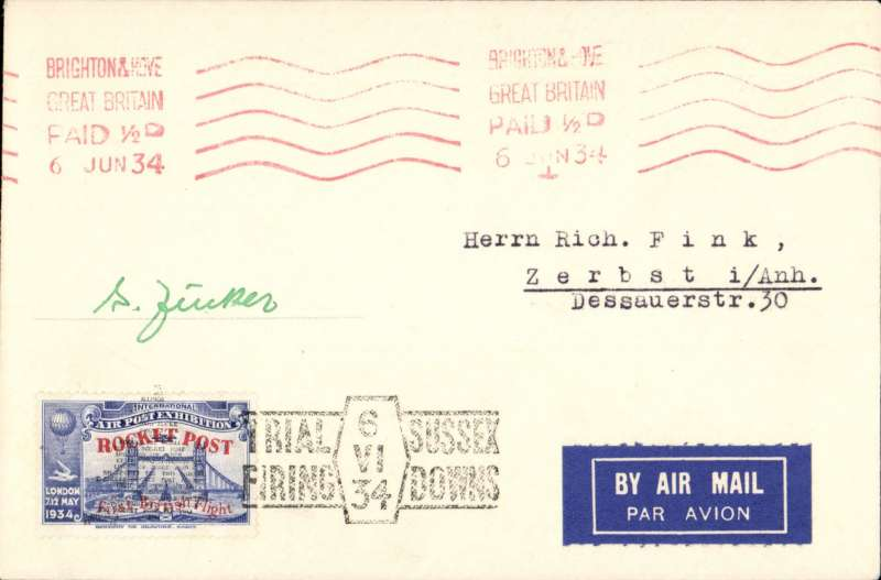 (GB Internal) Cover flown on Zucker's first trial rocket flight on the Sussex Downs, bearing blue 1934 Apex vignette overprinted red for the rocket post, hand stamped with the trial firing cachet in black , red machine postmark  Brighton 6 June 1934. Signed by Gerhard Zucker.