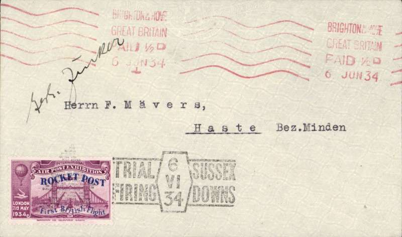 (GB Internal) Cover flown on Zucker's first trial rocket flight on the Sussex Downs, bearing purple 1934 Apex vignette overprinted blue for the rocket post, hand stamped with the trial firing cachet in black, red machine postmark  Brighton 6 June 1934. Signed by Gerhard Zucker.