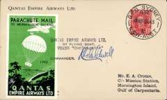 (Australia) Qantas Christmas 'parachute mail to Mornington Island by 'Coolangatta', Qantas company cover postmarked Sydney Air 24/12/46, endorsed on arrival at Mornington Island by JB McCarthy, Missionary in Charge, green/black/white commemorative vignette dated 1943, signed by the pilot Capt K G Caldwell.