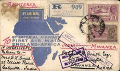 (India) First dispatch of mail from India to East Africa entirely by air, Bombay to Dar Es Salaam, bs 25/3, via Mwanza 23/3, registered (label) souvenir map cover franked 13 annas, carried by Trans-Indian Air Service to Karachi, then Imperial AW Eastern service to Cairo, then on F/F IAW London to  East Africa service to Mwanza. Some damage top lh corne causing two small holes on front only, otherwise fine (see scan).