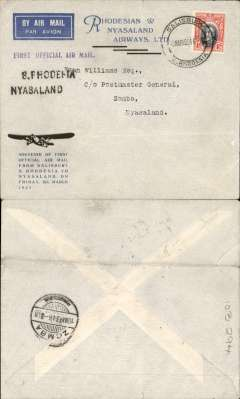 """(Southern Rhodesia) RANA F/F Salisbury to Zomba, bs 10/3, black two line """"S Rhodesia Nyasaland"""" hs's, official souvenir  cover with trimotor plane and text franked 4d. Ironed horizontal crease and 5mm non invasive closed top edge tear."""
