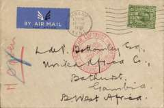 """(Gambia) German airmail service, inward air cover to Gambia from Great Britain, London to Bathurst, bs 14/3, carried on the German trans Atlantic catapult service, flight L 149, from Stuttgart to Brazil via Gambia, plain etiquette cover franked GB GV 6d, canc Sidcup cds, special red circular """"Deutsche Luftpost/Europa-Sudamerika"""" cachet enclosing a representation of a Zeppelin and a flying boat over water. One of the last covers to be routed via Stuttgart before the terminus was altered to Frankfurt in April 1936. See McCaig's article on West African Airmails, pp 25-34, Postal History Journal, June 1981, which includes illustrations of several covers flown on this service, and one very similar to this present item."""