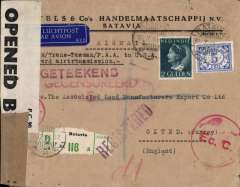 (Netherlands East Indies) WWII dual censored cover flown by air 'Two Ocean/All the Way by Air' from Batavia to England, bs 5/9, via Honolulu 09/8 transit cds, registered (label) cover franked 2G 5c canc Batavia cds, sealed black/brown 'Door Censuur Geopend' NEI censor tape tied by red NEI censor mark also red '....Geteekend/Gecensureed'  and red 'Ec.C' NEI censor marks, and resealed with B&W GB/Caribbean PC90 OBE 31842216 censor tape, typed 'KLM/Trans-Tasman/PAA to USA/Onward air transmission'. Carried by KNILM to Sydney, via Trans Tasman to Auckland, Pan Am FAM9 to San Francisco, US internal air service to New York, Pan Am FAM18 to Lisbon, and European air service to England. A well documented WWII item with great routing. Two small non invasive closed top edge tears. Do not detract, see image.