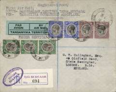 """(Tanganyika) Dar es Salaam to England, bs 31/10, carried on Tanganyika Government Feeder Service from Dar es Salaam to Mombasa, by train to Nairobi, by Wilson Airways to Kisumu, to connect with Imperial Airways flight AN33 to London. Registered (label) cover, correctly rated 120c, nice strike oval blue 'Tanganyika Territory/Feeder Service' hs, tying registration label, typed endorsement """"First Air Mail/ Dar es Salaam-Zanzibar-Tanga-Mombasa/By Tanganyika Government Aeroplane"""", blue green/black 'Par Avion/Tanganyika Territory' etiquette. Scarce item with great routing.."""