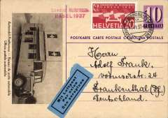 (Switzerland) Swiss Automobile Post Office 10c PSC with B&W picture of a Bureau de poste autombile franked with additional 20c and cancelled with fine 'Schweiz Automobile Post Bureau cds, blue/black trilingual 'Par Avion' etiquette. Sent from the Swiss Pattern Fair, Basel by air to Germany.