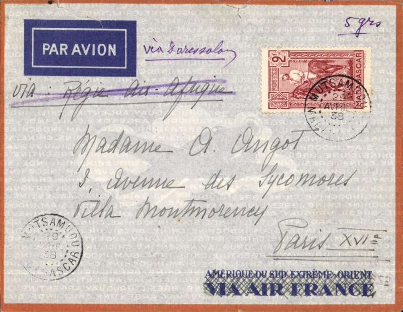 (Scarce and Unusual Routings) Madagascar to France, MUTSAMUDU TO PARIS,  carried by train,  postal van and river barge to the Madagascar port of Majunga bs 5/5 cds via Fomboni 2/5 transit cds, then by a Messageries Maritimes paquebot ' to Dar es Salaam  where transferred to the IMPERIAL AIRWAYS AFRICA NORTHBOUND FLYING BOAT SERVICE likely DN91 which left Dar es Salaam 13/5 , flown all the way on 'Capella' arriving Marseille one day late on 18/5. Orange border Air France cover FRANKED 65c ordinary and 2F air surcharge. Great aerophilatelic item, scarce origin, likely road,rail, river, sea and air journey.