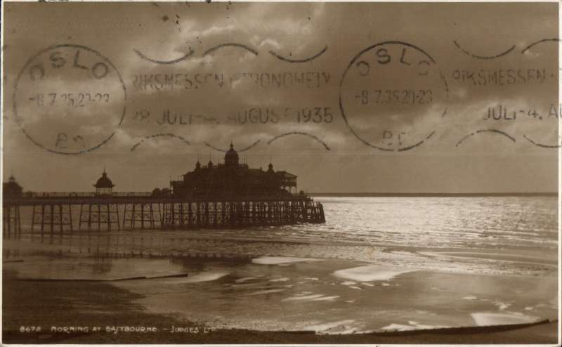 (GB External) Airmail to ship, Eastbourne to Hammerfest, Norway, fine arrival ds's on front and verso, sepia PPC showing Eastbourne pier in early morning, franked blue 2 1/2d SG (uncommon on cover), addressed to the ship's purser RMS Carinthia. A Cunard transatlantic passenger liner. converted into an armed merchant cruiser at start of WW II, and was torpedoed and sunk off Irish coast in 1940. Interesting.