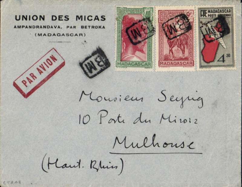 "(Scarce and Unusual Routings) Madagascar to France, BETROKA TO MULHOUSE, bs 1/2. Imprint etiquette cover slightly over franked 13F 90c (correct rate 13F50 - 1.50F ordinary up to 20gm + 4x3F per 5gm air), fine strikes of SCARCE UNDATED boxed 'BM' hs's indicating posting in a BOX on a PO lorry and carriage by road to Tananarive where it was transferred to the SERVICE DE LA AERONAUTIQUE CIDILE and flown all the way  by air to Paris bs 25/1. In 1936 ""sections d?aviation populaire"" (SAP), were created by the Popular Front to popularize flight training for young people with the aim of training more crew for French military aviation.  Uncommon origin, scarce postal marks and good routing. A nice item."