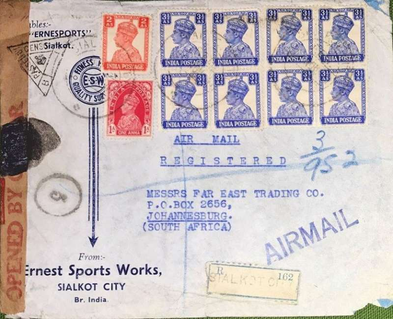 (India) WWII censored registered (label) airmail from Sialkot to Johannesburg, carried to Karachi by Indian National Airways and from Karachi to Johannesburg by BOAC over the EMERGENCY HORSESHOE FLYING BOAT ROUTE established after Italy entered the War in June 1940. Commercial corner double rate cover franked  31 annas (2x14 + 3 reg fee), sealed India crown over OBC censor tape tied triangular black Karachi  triangular censor mark, Nibble lower rh corner.
