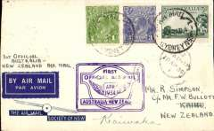 """(Australia) """"Faith in Australia"""", first official airmail Australia-New Zealand, Kaihu 18/4 arrival ds's front and verso, special blue/white 'Air Mail Society of N.S.W' souvenir cover correctly rated 7d, canc Sydney cds, violet winged """"First Official Air Mail"""" Australia-New Zealand flight cachet."""