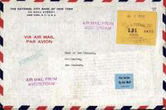 """(United States) Acceptance of United States airmail for New Zealand, New York to Wellington, carried by sea on SS Normandie to Le Havre to connect with the new KLM/KNILM Amsterdam-Batavia-Denpassar-Sydney through airmail service, then by sea to NZ. Interbank cover printed  'Via Airmail/Par Avion'  franked New York $1.91 meter postage Jul 9, 1938, green straight line """"Normandie"""" hs, violet two line """"Airmail From Amsterdam"""" hs's, two 'National City Bank of New York' seals verso. The F/F of this service was on 28/6/1938.  SS Normandie entered service in 1935 as the largest and fastest passenger ship afloat and remains the most powerful steam turbo-electric-propelled passenger ship ever built.. A great exhibit item."""